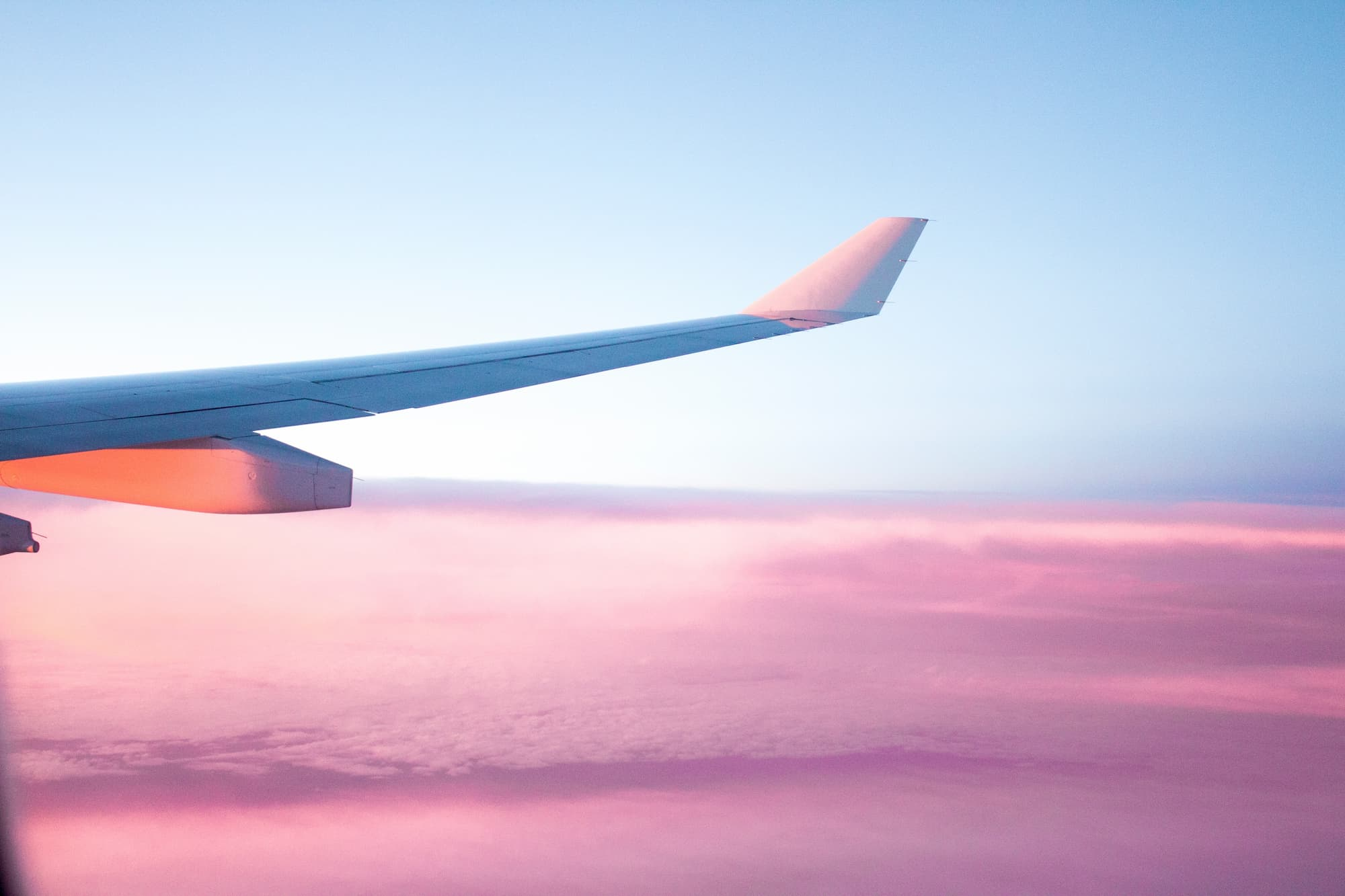 aircraft wing with purpel sky in the background
