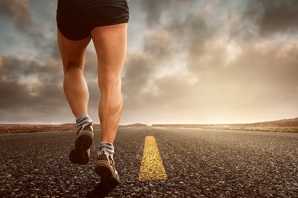 A guy running on an empty road