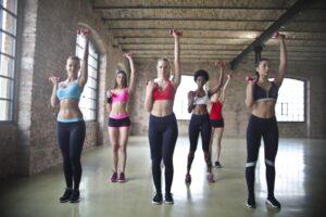 6 beautiful girls wearing yoga pants practicing group exercises